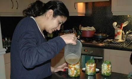 Homa Khaleeli in kitchen making pickles