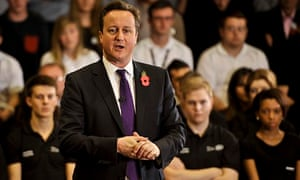Cameron tours the Mini car plant in Oxford.