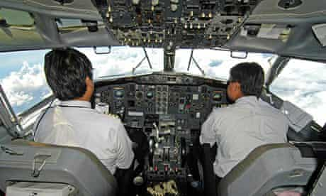 A pilot and co-pilot in a civilian aircraft cockpit