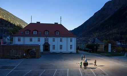People gather in front of the town hall of Rjukan,