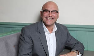 Gregg Wallace sat at table at his restaurant 'Wallace and Co'  in Putney, London