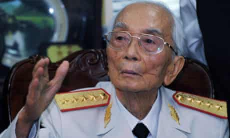 General Vo Nguyen Giap in military uniform, waving