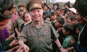 General Vo Nguyen Giap shakes villagers hands