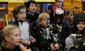 young children dressed as skeletons and vampires