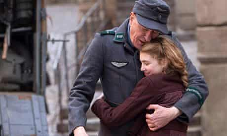 Geoffrey Rush and Sophie Nelisse hug in a scene from The Book Thief