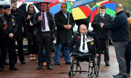 Veterans and strangers joined relatives at the funeral.