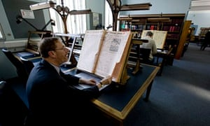 A reader looks at a copy of the Yorkshire Post at the Colindale archive