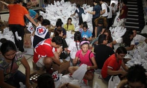 Philippine Red Cross volunteers packing relief goods for typhoon-affected families.