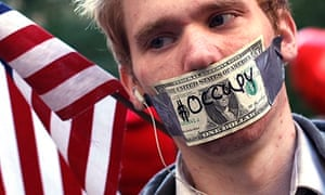 An Occupy Wall Street demonstrator … the group has put its money where its mouth is.