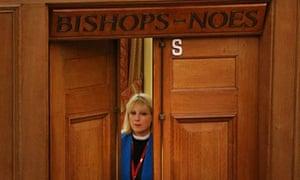 Reverend Rosie Harper stands in the doorway of the now unused 'Bishops Noes' voting lobby before spe