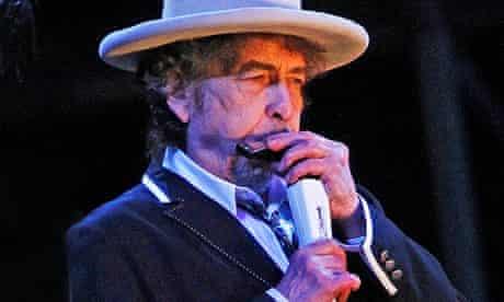 Bob Dylan playing harmonica