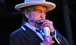 Bob Dylan playing harmonica