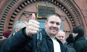 Anthony Perrett giving thumbs up outside jail