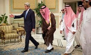 John Kerry, with the Saudi Foreign minister (in brown), Prince Saud al-Faisal bin Abdulaziz Al Saud