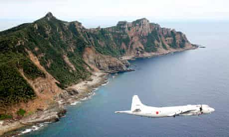 A Japanese surveillance plane flies over the disputed islands in the East China Sea