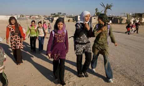 Bedouin children walk to school in the Negev desert