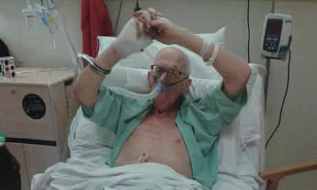 Michael Tyrrell handcuffed to his hospital bed the day before he died. His daughter took the photo