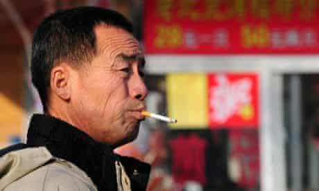 A man smokes his cigarette in Beiijng