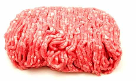 Raw beef mince on a white background