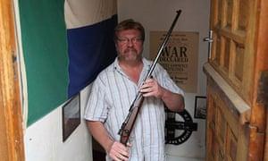 Mandela walk: Colin Steyn holding rifle