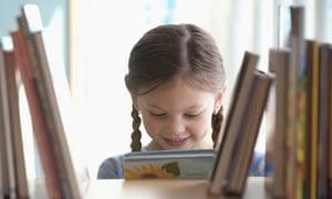 Girl taking book from shelf