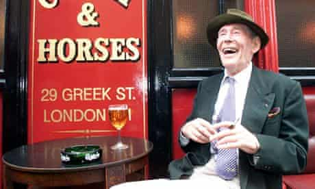 Peter O'Toole laughing outside pub