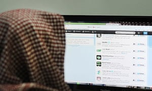 A man browses Twitter on his computer in Riyadh