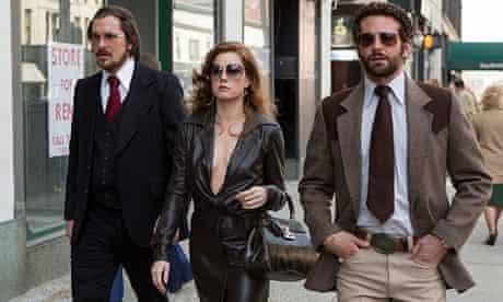 American Hustle: Christian Bale, Amy Adams and Bradley Cooper walking in street