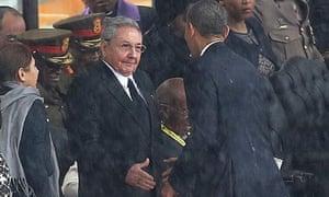 Barack Obama shakes hands with Cuba's President Raúl Castro at a memorial service for Nelson Mandela