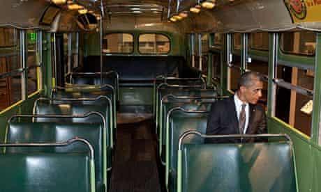 Barack Obama sits on the Rosa Parks bus