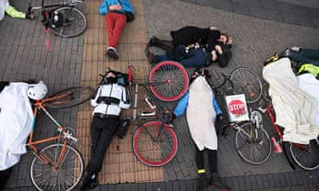 Cycling Group Hold die-in safety Protest