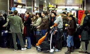 Passengers at Bucharest's Henri Coanada Airport.