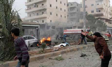 A man gestures following the air raid in Raqqa