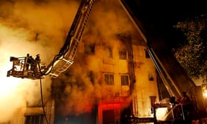 Bangladeshi firefighters battle a fire at Tazreen garment factory in Savar