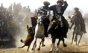 Afghan horsemen play the traditional buzkashi, in Kabul.