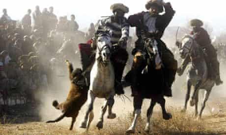 Afghan horsemen play the traditional buzkashi, in Kabul.
