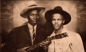 """Robert Johnson poses with fellow blues musician Johnny Shines in the newly released photograph."""