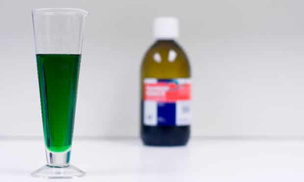 Bottle of methadone and measuring glass. Image shot 2010. Exact date unknown.
