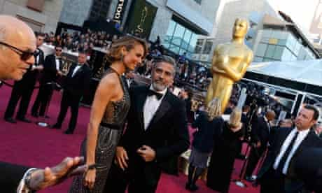 George Clooney and girlfriend Stacy Keibler arrive at the 85th Academy Awards in Hollywood