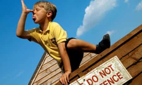 Boy on fence