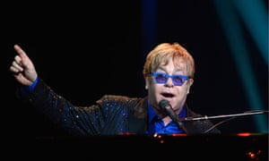 Elton John performs in 2012; he is to team with Queens of the Stone Age