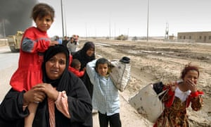 A family of Iraqi civilians fleeing Basra in southern Iraq in March 2003.