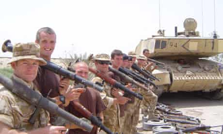 James Jeffrey with his troop and a haul of captured weapons in Iraq.
