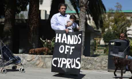 Cypriots protest outside the parliament