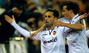 Valencia's Brazilian midfielder Jonas (L