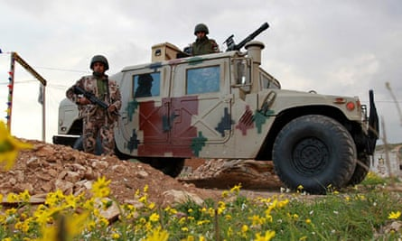 Jordanian soldiers stand guard on Syria border