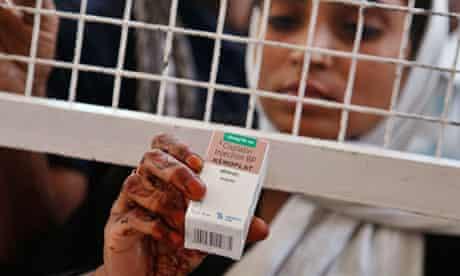 Indian woman buys medicine
