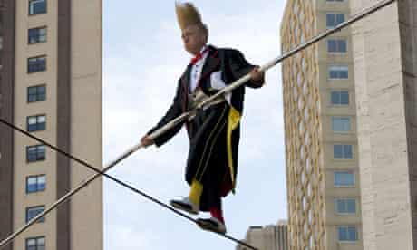 Circus performer balances on high wire