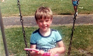 A young Damian Barr on a swing.
