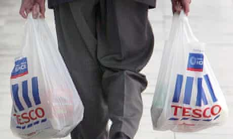 Man carries Tesco shopping bags